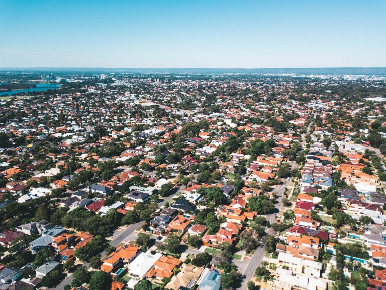 writing multiple real estate offers - aerial view of a neighborhood