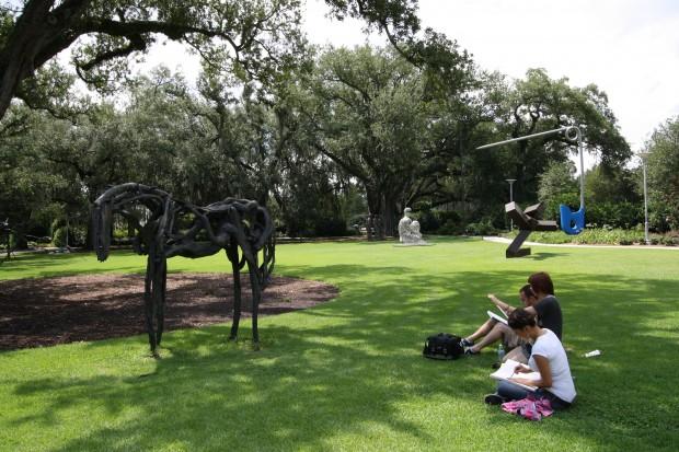 Students sketching in the sculpture garden